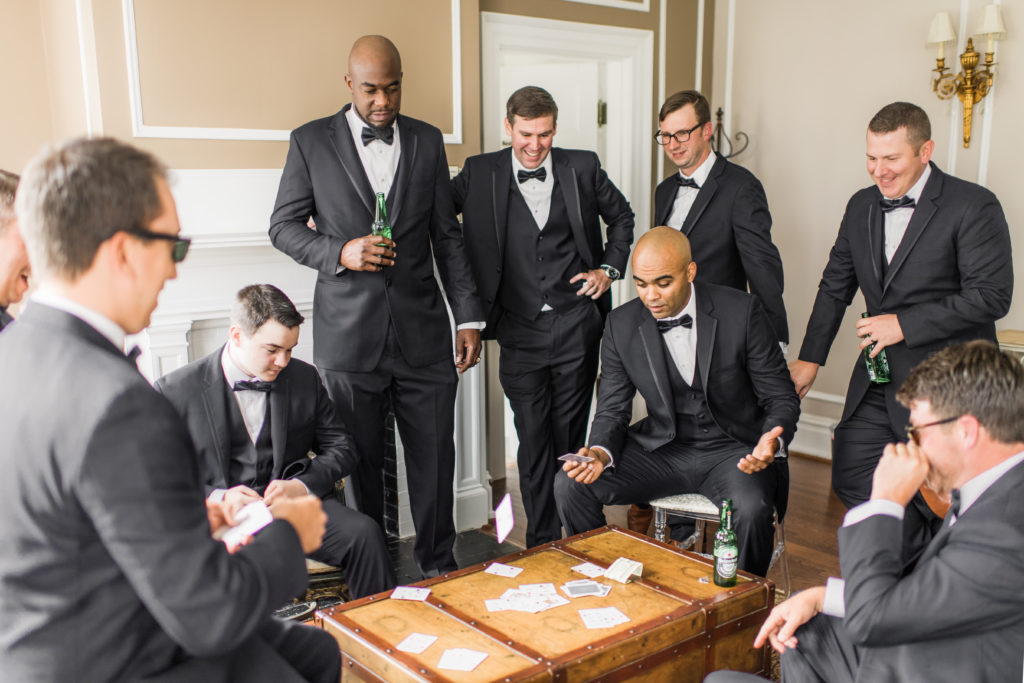 Groom and Groomsmen playing cards on a chest