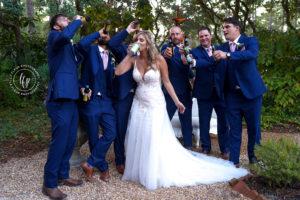 Groomsmen toasting the bride