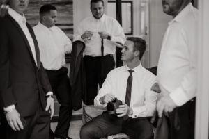 Groom and Groomsmen getting dressed for the wedding