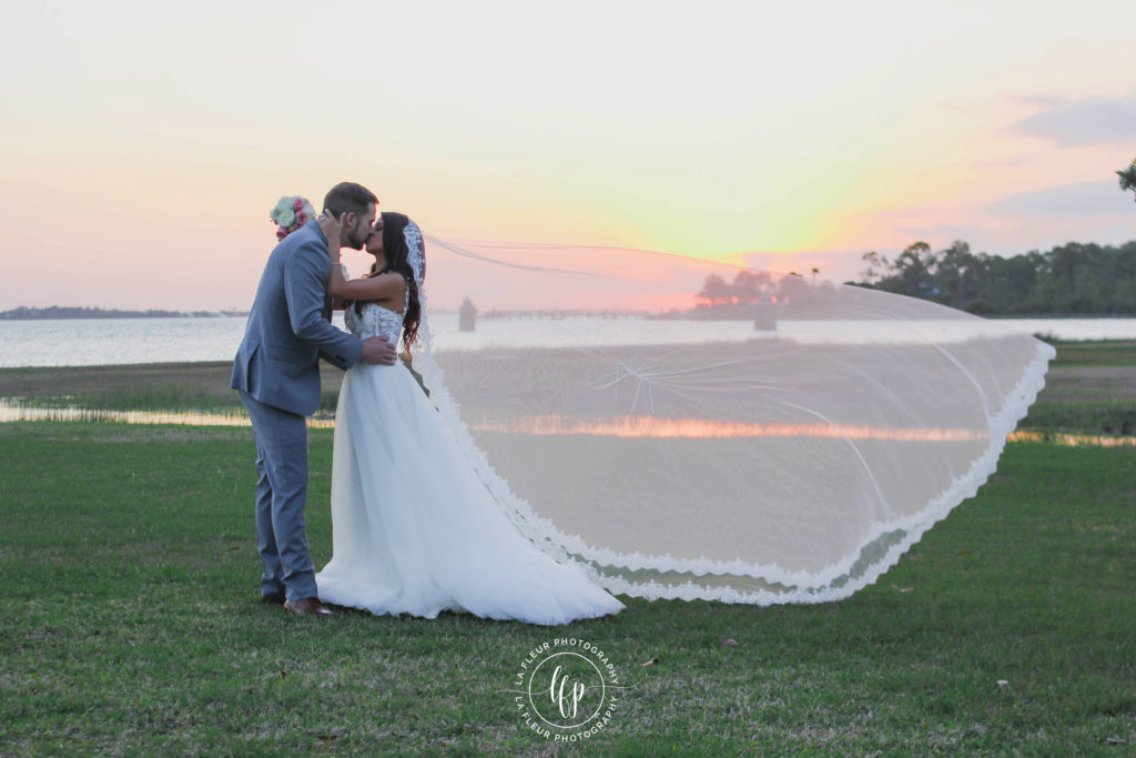 Wedding photograph on grass with sunset