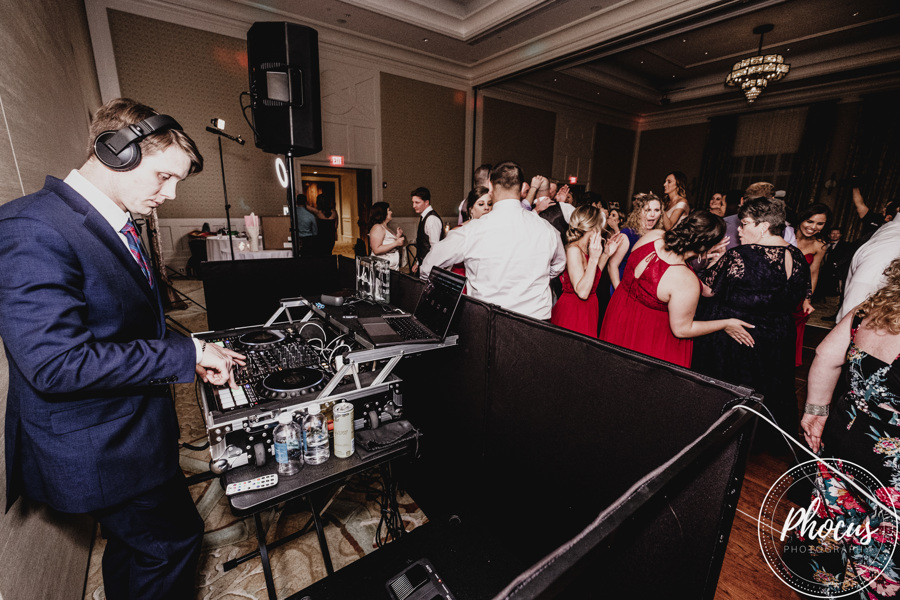 Phocus Photography capturing DJ Josh in the mix at a wedding that they were on the event team for.